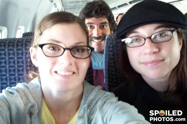 - why are they taking their pic on a plane???